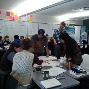 To help foster the land use and transportation planning connection, BC Transit planning staff have been facilitating transit planning workshops, here BC Transit's Regional Planning Work Lead Matthew Boyd, MCIP, RPP (standing) with Vancouver Island University Masters of Community Planning students.