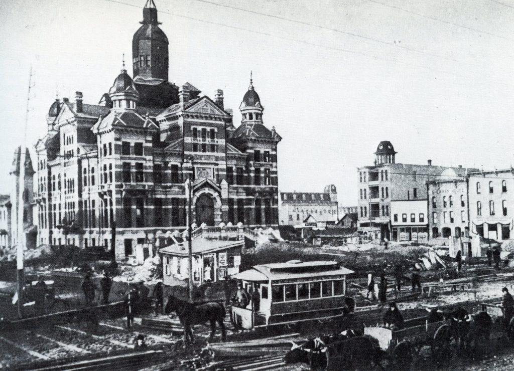 The start of transit in Winnipeg: horse drawn street car on Main Street in front of the city's old (and now demolished) city hall. (Source: BACKTRACKS The Story of Winnipeg's Streetcars, http://edgelandfilms.com/backtracks-the-story-of-winnipegs-streetcars/)