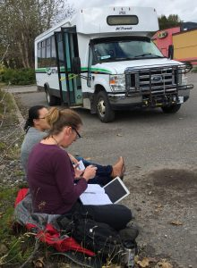 Transit planning in the real world: borrowing a curb in Houston, BC to discuss details for new interregional transit in northern BC's Highway 16 corridor. (With Transportation Planner Adriana McMullen, left) Photo: L. Trotter
